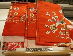 Two embroidered satin door panels