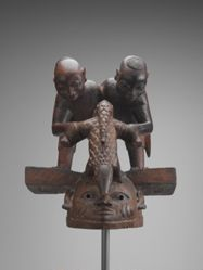 Gelede Mask with Two Male Figures and a Pangolin