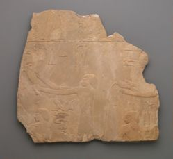 Relief depicting men pouring libations