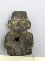 Hollow seated figurine