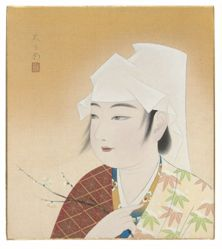 Woman holding a branch of flowering plum
