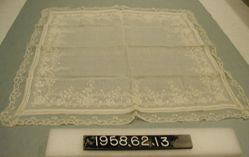 Large, fine, linen handkerchief; embroidered and lace-trimmed