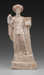 Terracotta figure of a standing female with casket