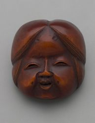 Wooden mask of Otafuku