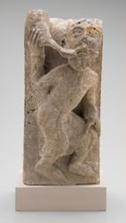 Corbel with Man Blowing Trumpet