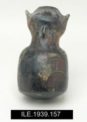 Effigy vase with round base