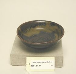 Shallow bowl with wide, hollowed out base.