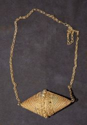 Biconical pendant on a chain
