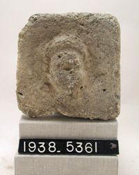 Plaster block with relief head