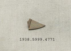 incised metal fragment