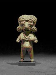 Standing pregnant female figurine