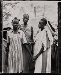 Akuot Nyibol (pregnant at center) with Riak Warabek and Akuot's daughter, Athok Duom, who is recovering from malaria, Sudanese refugee camp, Lokichoggio, Kenya