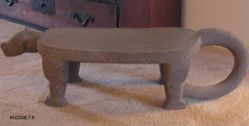 Metate in shape of feline