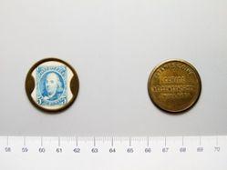 Brass store card of Benjamin Franklin for Nelson T. Thorson, Omaha, Nebraska