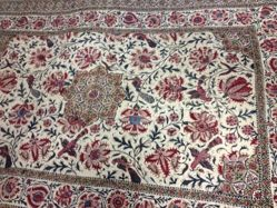 Mat of quilted cotton with printed design