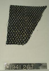 Fragemt of plain cloth, resist dyed or printed