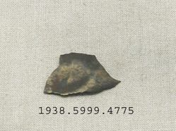 Fragment of bronze plate