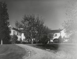 "Exterior view of Katherine S. Dreier's West Redding home, ""The Haven"" -- with arched separation between house and garage"