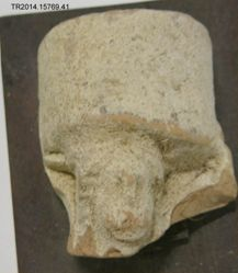 Mounted stucco covered fragment