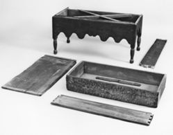 Chest-on-frame base with five related chest pieces
