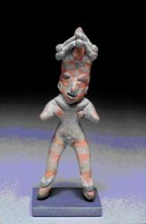 Standing female figurine with face paint and stripes on legs