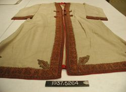 Coat of wool twill trimmed with tapestry bands & embroidery