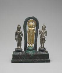 Standing Buddha Flanked by Padmapani and Vajrapani
