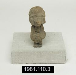 Seated figurine holding smaller figure