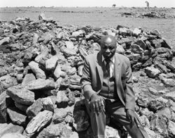 """Luke Kgatitsoe in the house, bulldozed in Febuary 1984 by the government after the forced removal of the people of Magopa, a black-owned farm, which had been declared a """"black spot"""", Ventersdrop district, Transvaal"""