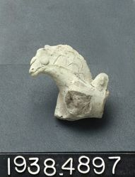 Clay figurine of horse's head with engraved mane