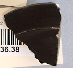 Black glazed lid fragment