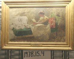 Woman Seated on Green Sofa