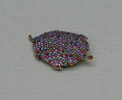 Multi-paveed turtle pin