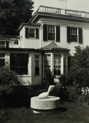 "Exterior view of Katherine S. Dreier's Milford home, ""Laurel Manor"" -- Brancusi's Leda, with Duchamp's Large Glass visible inside picture window"