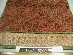 Quilted mat of interlocking twill tapestry