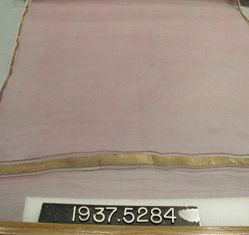 Scarf of plain cloth with twill borders