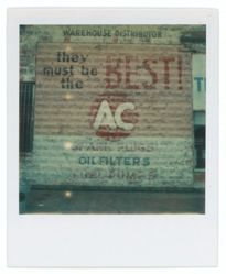 Untitled [Sign: Advertisement for AC Spark Plugs]