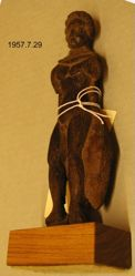 Wooden figurine of nude man with cape of some spotted skin.