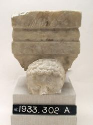 High Relief Statuette of Boy on Pillar
