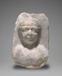 Plaster block with relief head