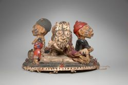 Headdress Featuring Human Figures and a Leopard Eating an Animal
