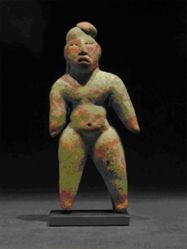 Standing figure with painted face and body