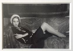 Renée Perle reclining