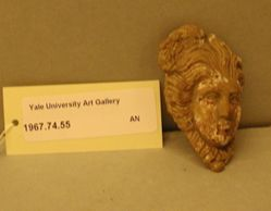 Applique of a head of Medusa.