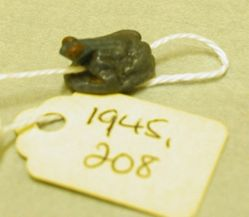 One of three frog amulets