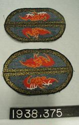 Pair of canvas embroidered ovals