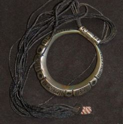 Circular pendant with leather necklace