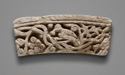 Relief fragment depicting a dove and grapevine