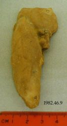 Fragment of standing male figurine