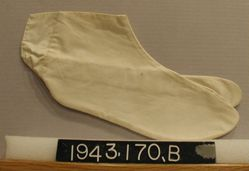 "Pair of ""tabis"", white cotton stocking feet"